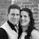 Couple posing for portraits after wedding.