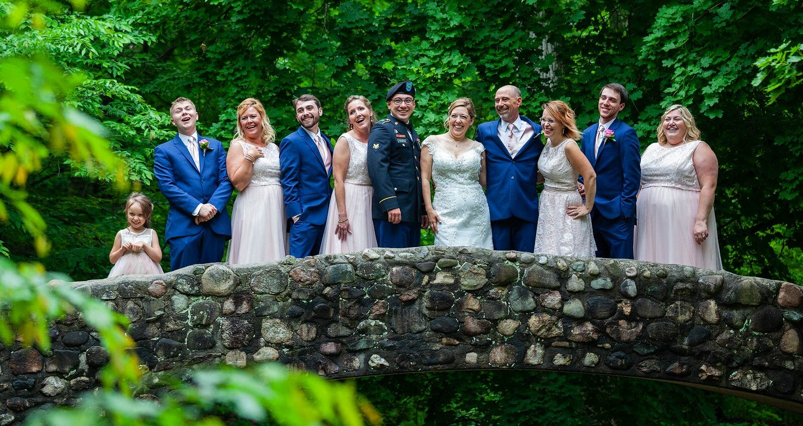 Wedding Photography - Fun Shot of Wedding Party on Stone Bridge - Paul Dekort Photographer