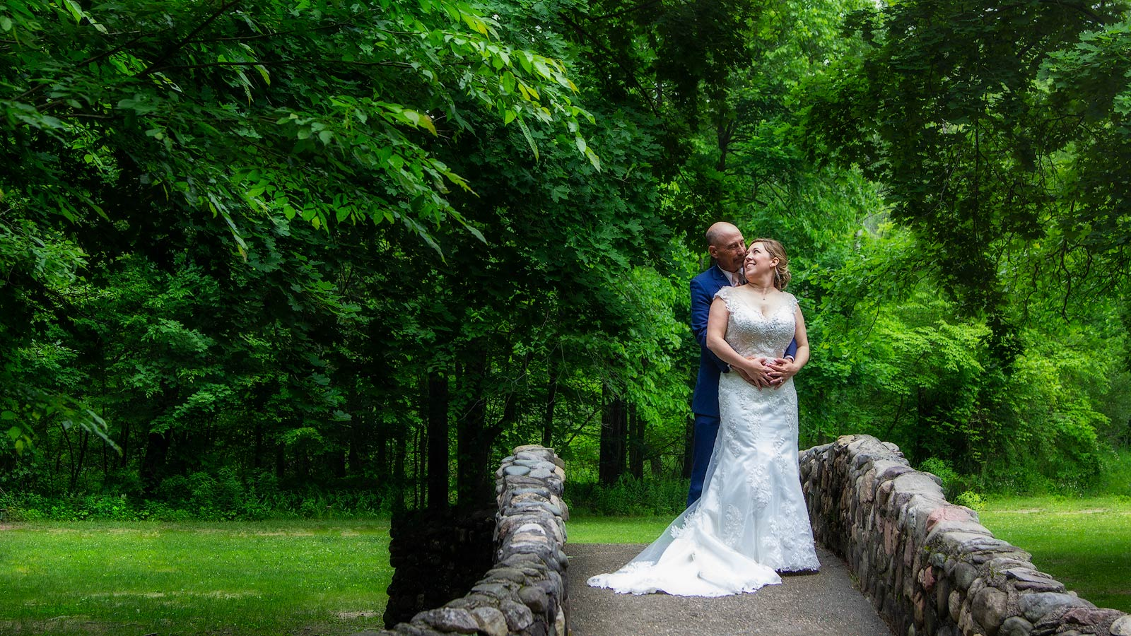 Wedding Photo Couple on Stone Bridge in Park