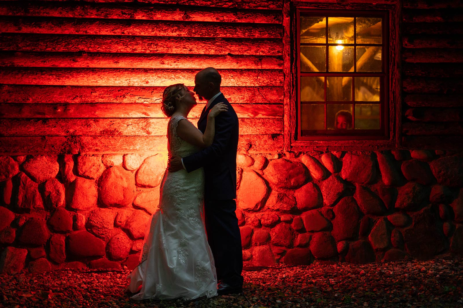 Wedding Photography - Bride and Groom Sneak Out for a Quick Kiss - Paul Dekort Photographer