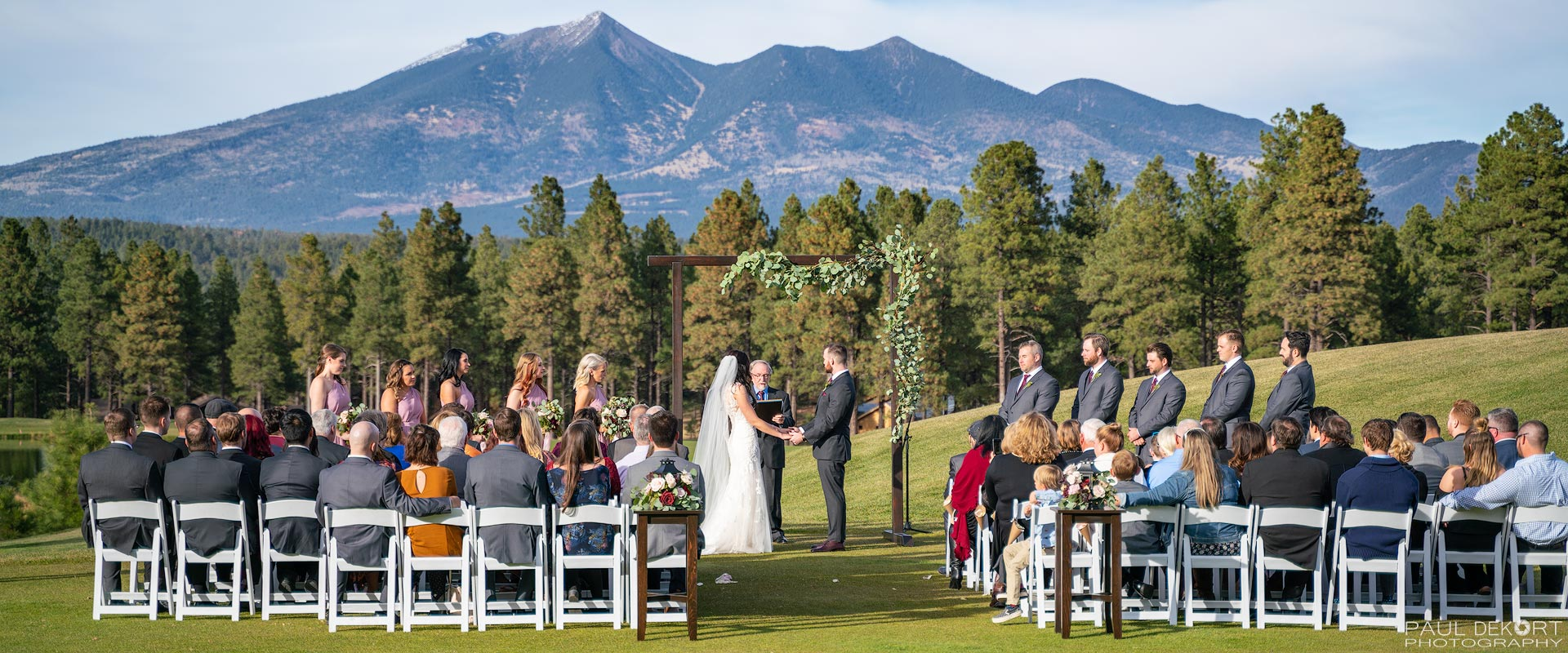 Wedding Photography of ceremony in front of Flagstaff mountains, Flagstaff, AZ.